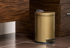 Waste bins in copper & gold